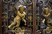 Medieval gate with angels — Stock Photo