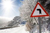 Sign on a mountain road — Stock Photo
