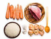 Carrots, meat, onions and rice — Stock Photo