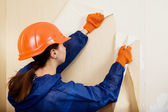 Worker removes old wallpaper — Foto Stock