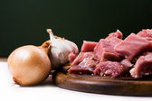 Meat with onions and garlic — Stock Photo
