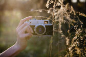 Retro camera in hand — Stock Photo