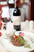 Well-done steak and red wine — Stock Photo