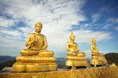 Three buddhas against the sky — Stock Photo