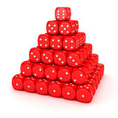 Pyramid from red dice — Stock Photo