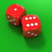 Two red dice on the green — Stock Photo