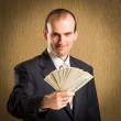 Businessman offer money — Stock Photo #31360915