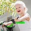 Baby riding bicycle — Stock Photo