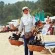 Thai woman selling souvenirs - Stock Photo