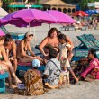 Foto Stock: Indisellers attack tourists