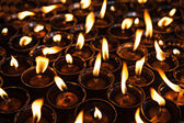 Many candles — Stockfoto