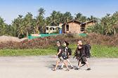 Backpackers walking — Stock Photo