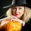 The charming witch cooks the potion on the eve of Halloween — Stock Photo