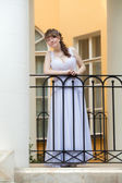 Bride on the balcony waiting for a loved one — Stock Photo