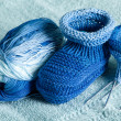 Ball of blue-blue melange threads for knitting of bootees to the — Stock Photo