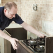 Постер, плакат: Craftsman kitchen carpenter at kitchen cabinet installation serv
