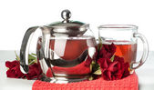 Scalded teapot and cup of tea — Stock Photo