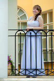 The dear beautiful bride on a balcony of the palace waits for da — Stock Photo