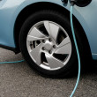Charging of an electric car — Stock Photo