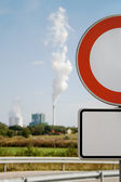 Red Road Sign. Out of focus - industrial building — Stock Photo