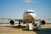 Airplane parked at the airport — Stock Photo