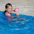 Royalty-Free Stock Photo: Happy girl in the pool with ball