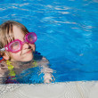 Royalty-Free Stock Photo: Little girl swimming in pool with goggles