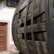 Very old large wine barrel, oval shaped,side view — Stock Photo #24815929