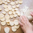 Grandma's hands roll out dough — Stock Photo #24816099