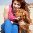 Woman with a dog — Stock Photo #13582827