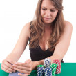 Woman playing poker - Stock Photo