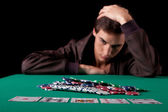 Man playing poker — Stock Photo