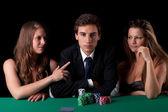 Man and women playing poker — Stock Photo