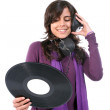 Beautiful girl with vinyl and headphones — Stock Photo #1483632