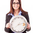 Businesswoman holding a clock — Stock Photo