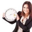 Businesswoman holding a clock — ストック写真