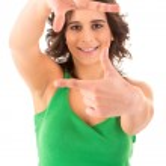 Young woman making framing key gesture — Stock Photo #23241796