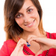 Beautiful woman making a heart shape — Stock Photo