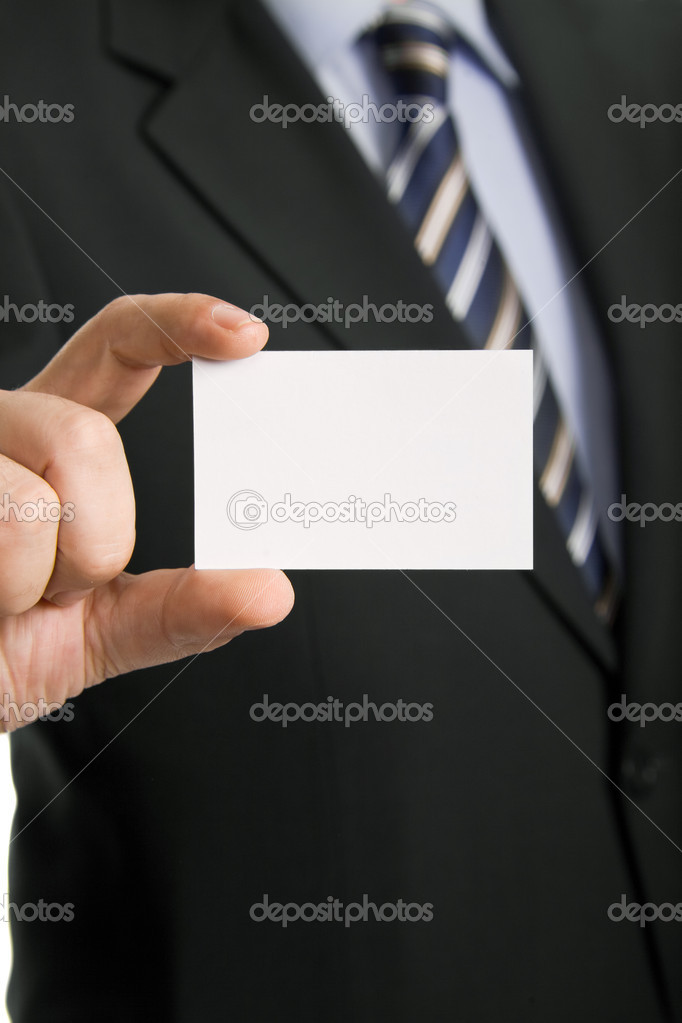 Hand of businessman offering business card on white background — Стоковая фотография #19947795
