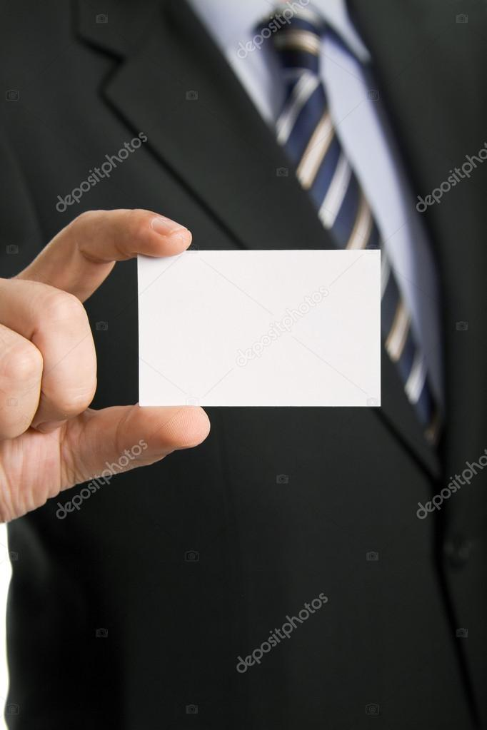 Hand of businessman offering business card on white background — Photo #19947795
