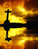 Cross detail in silhouette and the clouds in the sky — Foto Stock