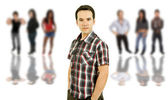 An young man in front of a group of — Stock Photo