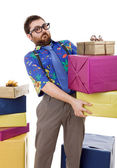 Happy silly salesman with some boxes, isolated on white — Stock Photo