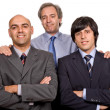 Photo: Three business misolated on white background