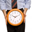 Businessman body parts with a clock covering him — Stock Photo