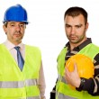 Stock Photo: Two workers isolated in a white background