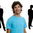 Young man portrait with some men in silhouette — Stock Photo