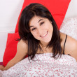 An young beautiful sensual woman in bed — Stock Photo