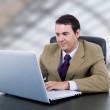 Young business man working with is laptop — Stock Photo