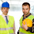 Stock Photo: Proud boss and worker standing looking at the camera
